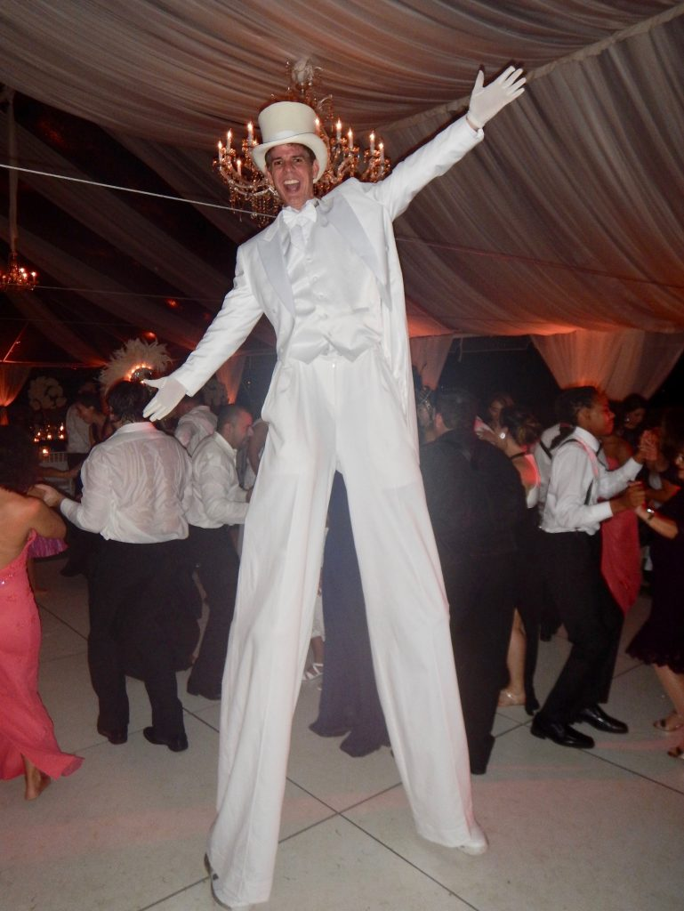 White Suit Stilt Walker